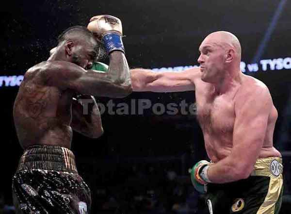 Tyson Fury punches Deontay Wilde