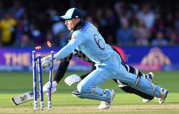 England's Jos Buttler runs out New Zealand's Martin Guptill to win the super-over to win the 2019 Cricket World Cup final between England and New Zealand at Lord's Cricket Ground in London on July 14, 2019. - England won the World Cup for the first time as they beat New Zealand in a Super Over after a nerve-shredding final ended in a tie at Lord's on Sunday | TotalPoster