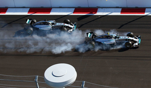 Nico Rosberg of Germany and Mercedes F1 Grand Prix locks up approaching turn two next to Lewis Hamilton of Great Britain and Mercedes F1 Grand Prix during the Russian Formula One Grand Prix at Sochi Autodrom in Russia | TotalPoster