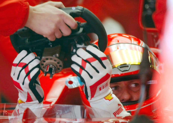 Michael Schumacher / Ferrari fits his steering wheel in the Pits | TotalPoster