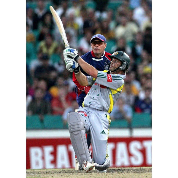 Adam Gilchrist hits a six against England during the Twenty20 cricket match between England and Australia at the Sydney Cricket Ground | TotalPoster
