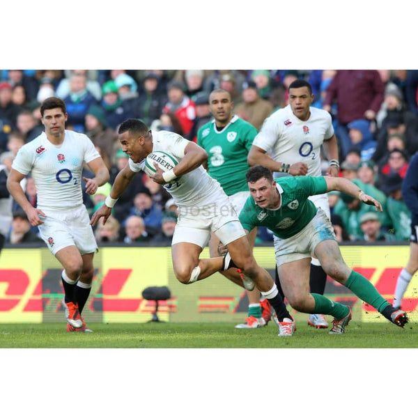 Anthony Watson of England is tackled by Robbie Henshaw of Ireland during the RBS Six Nations match between Ireland and England at the Aviva Stadium in Dublin | TotalPoster