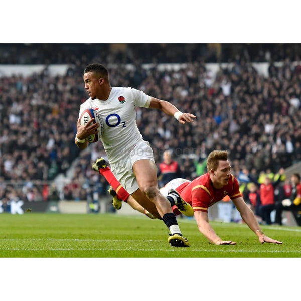Anthony Watson evades a tackle from Liam Williams to score his team's opening try during the RBS Six Nations match between England and Wales at Twickenham Stadium | TotalPoster