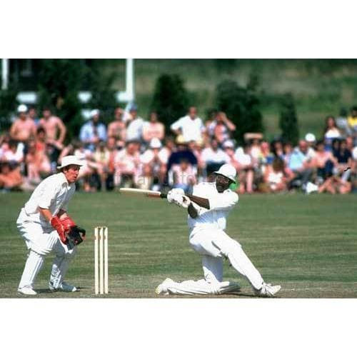 West Indies Captain Clive Lloyd hits a four during his century innings in the match against Northampton in Milton Keynes | TotalPoster
