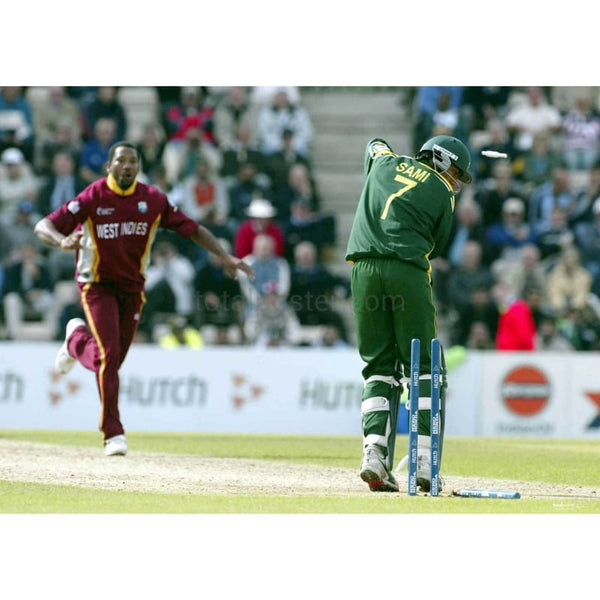 Mohammad Sami is bowled out by Corey Collymore during the ICC Champions Trophy 2004 Semi Final match between West Indies and Pakistan at the Rosebowl  | TotalPoster