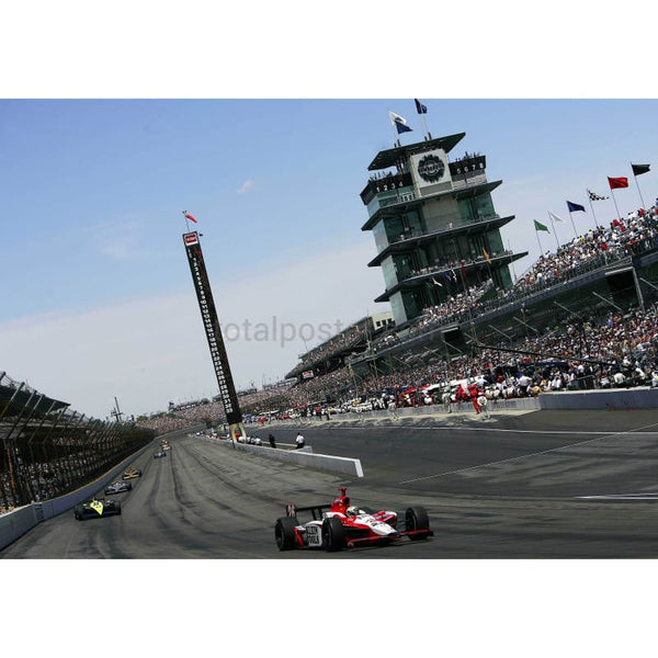 Dan Wheldon on his way to victory in the 89th Indianapolis 500 | TotalPoster