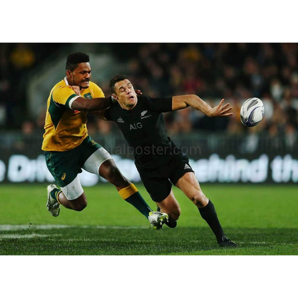 Daniel Carter offloads in the tackle from Henry Speight during The Rugby Championship, Bledisloe Cup match between the New Zealand All Blacks and the Australian Wallabies at Eden Park New Zealand | TotalPoster