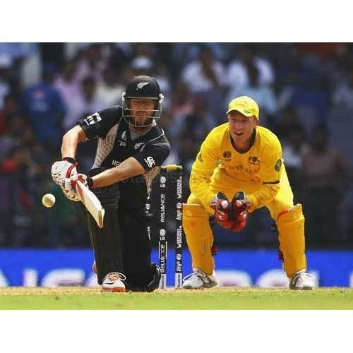 Daniel Vettori hits the ball as Brad Haddin looks on during the 2011 ICC World Cup Group A match between Australia and New Zealand at Vidarbha Cricket Association Ground | TotalPoster