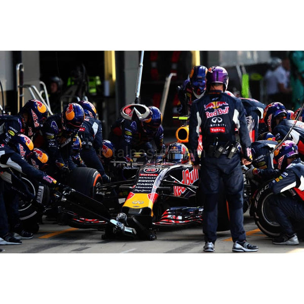 Daniil Kvyat / Infiniti Red Bull Racing makes a pit stop during the Formula One Grand Prix of Great Britain at Silverstone Circuit in Northampton | TotalPoster