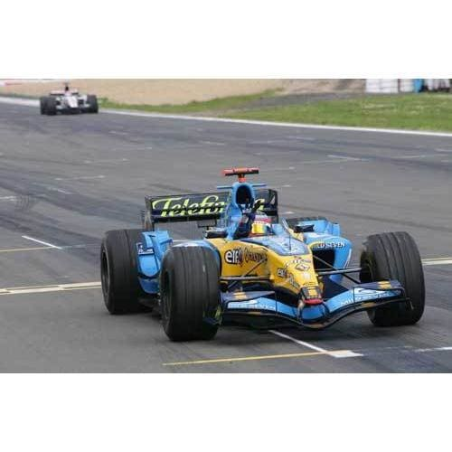 Fernando Alonso crosses the line to win the European Grand Prix at the Nurburgring | TotalPoster