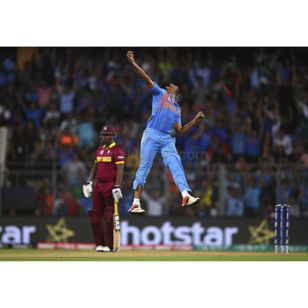 Jasprit Bumrah celebrates during the ICC World Twenty20 India 2016 Semi Final match between West Indies and India | TotalPoster