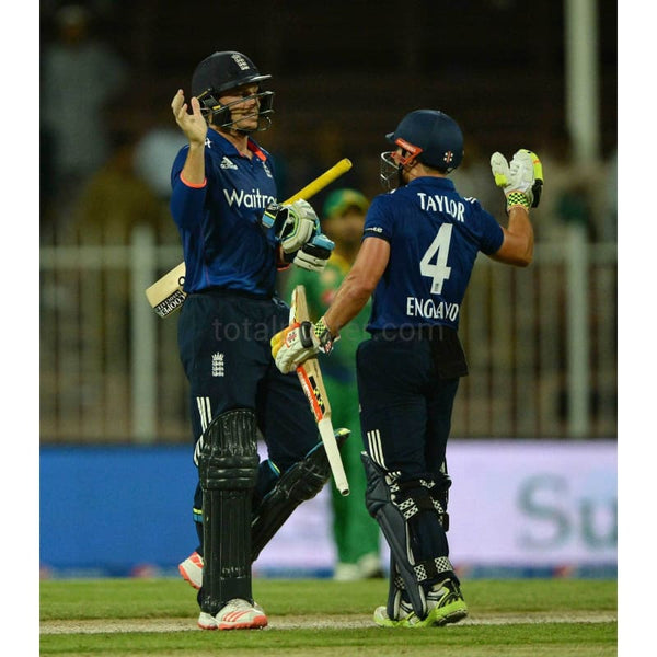 Jos Buttler and James Taylor celebrate after winning the 3rd One Day International match between Pakistan and England at Sharjah Cricket Stadium | TotalPoster