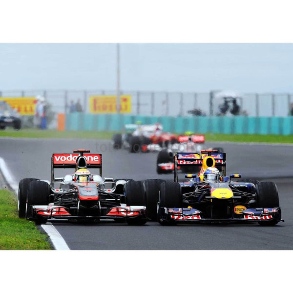 Lewis Hamilton / McLaren and Sebastian Vettel / Red Bull Racing race side by side during the Hungarian Formula One Grand Prix at the Hungaroring | TotalPoster