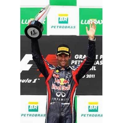 Mark Webber / Red Bull Racing celebrates on the podium after winning the Brazilian Formula One Grand Prix at the Autodromo Jose Carlos Pace | TotalPoster