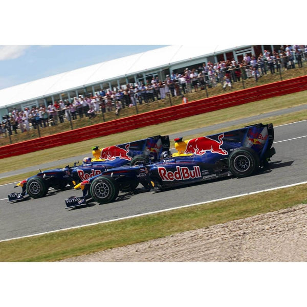 Mark Webber / Red Bull Racing and Sebastian Vettel side by side at the start of the British Formula One Grand Prix at Silverstone | TotalPoster