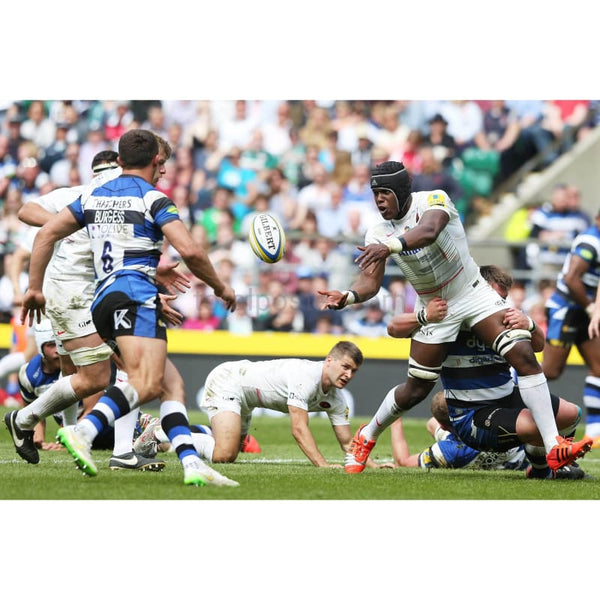 Maro Itoje of Saracens offloads in the tackle during the Aviva Premiership Final between Bath Rugby and Saracens at Twickenham Stadium | TotalPoster