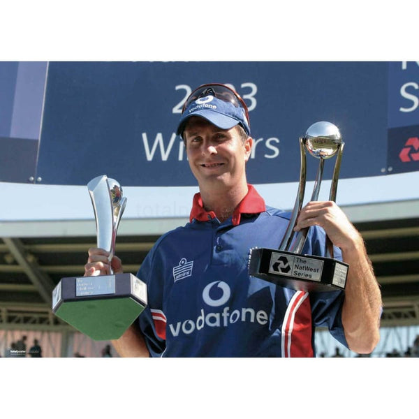 England`s Michael Vaughan with celebrates with the trophy after victory in the Natwest Challenge Final at Lords | TotalPoster