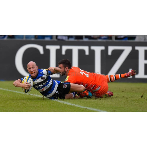 Peter Stringer scores despite the tackle of Tommy Bell during the Aviva Premiership semi final match between Bath Rugby and Leicester Tigers at the Recreation Ground in Bath | TotalPoster