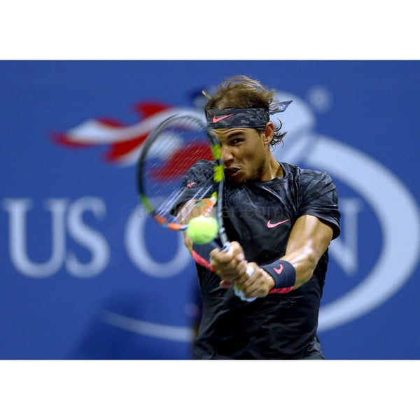 Rafael Nadal hits a return during the US Open at Flushing Meadows TotalPoster