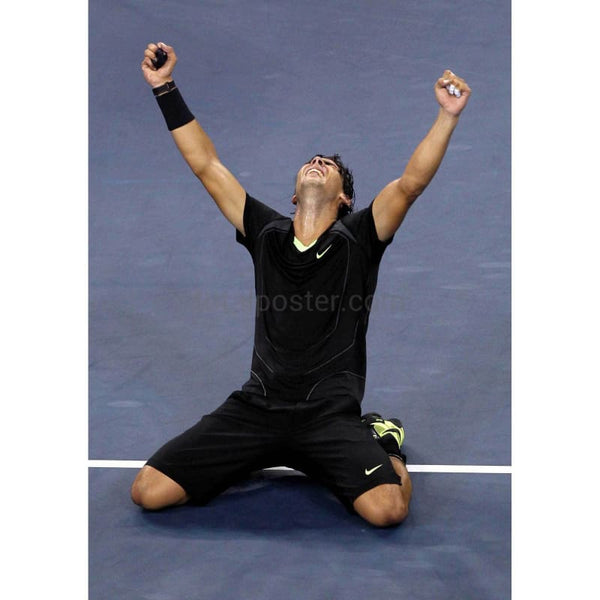 Rafael Nadal kneels in celebration after victory in the US Open TotalPoster