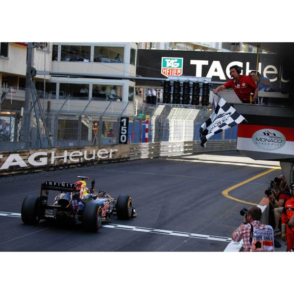 Sebastian Vettel / Red Bull Racing celebrates as he crosses the finishing line to win the Monaco Formula One Grand Prix at the Monte Carlo Circuit | TotalPoster