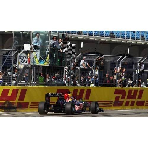 Sebastian Vettel / Red Bull Racing crosses the finish line to win the Turkish Formula One Grand Prix at the Istanbul Park | TotalPoster