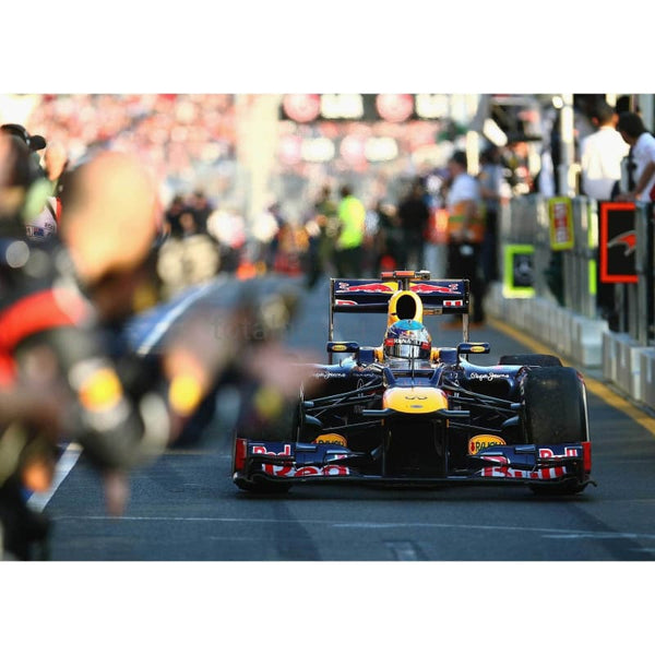 Sebastian Vettel /Red Bull Racing drives down the pitlane to parc ferme following the Australian Formula One Grand Prix at the Albert Park circuit | TotalPoster