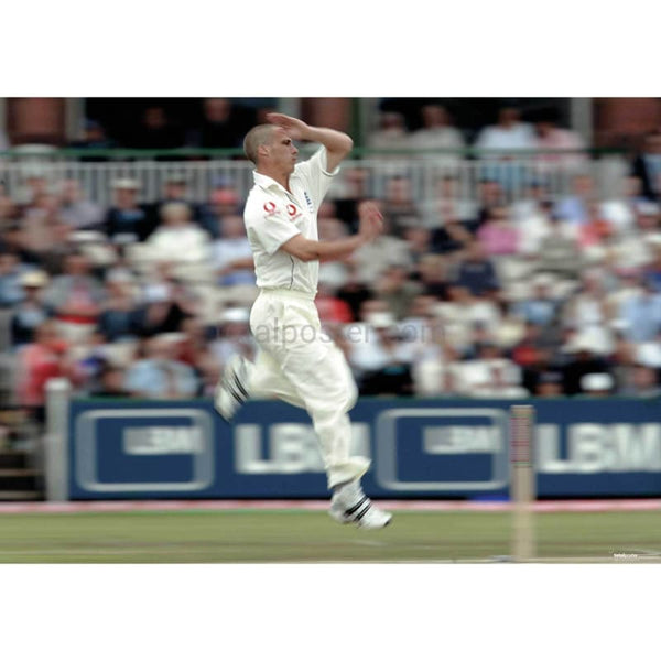 Simon Jones in action during the Ashes npower third test between Austraila and England at Old Trafford | TotalPoster