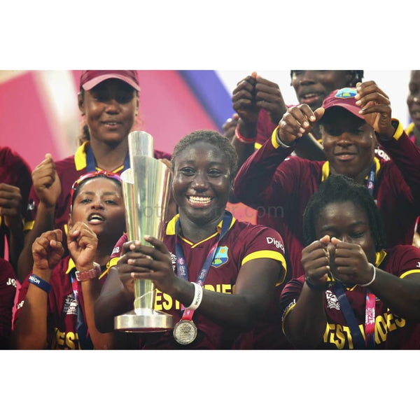 Stafanie Taylor, Captain of the West Indies celebrates with the trophy after the Women's ICC World Twenty20 India 2016 Final match between Australia and West Indies at Eden Gardens | TotalPoster