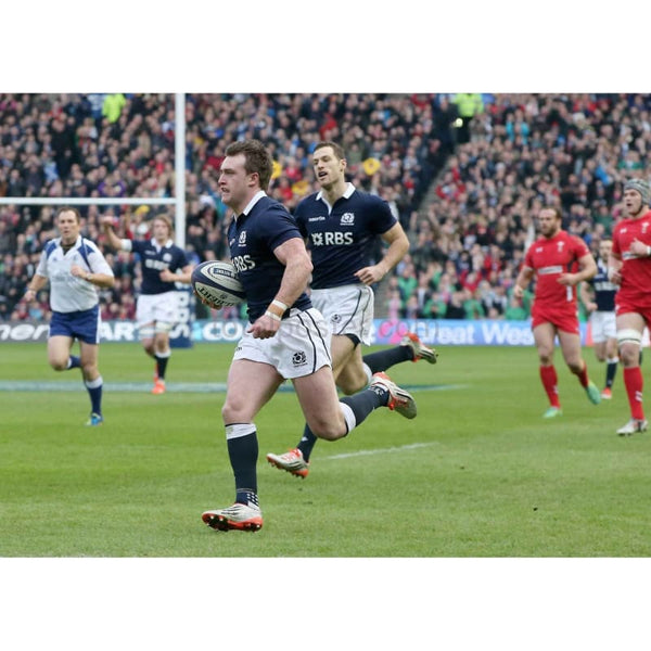 Stuart Hogg of Scotland runs in the opening try during the RBS Six Nations match between Scotland and Wales at Murrayfield Stadium in Edinburgh, Scotland | TotalPoster