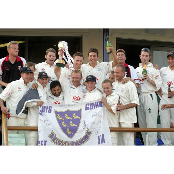 Sussex Captain Chris Adams lifts the trophy as the Team celebrate winning the Frizzell County Championship | TotalPoster