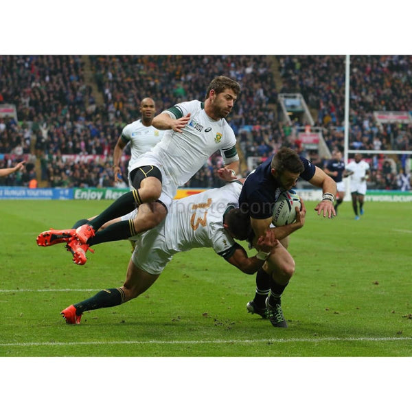 Tommy Seymour evades the South Africa tackles as he scores a try during the 2015 Rugby World Cup Pool B match between South Africa and Scotland at St James' Park | Poster