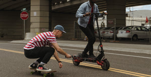 zero 10x adult electric scooter riding with skateboard