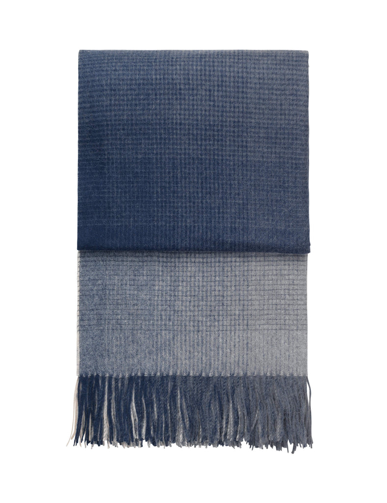 Dark blue ombre throw blanket folded on a white background.