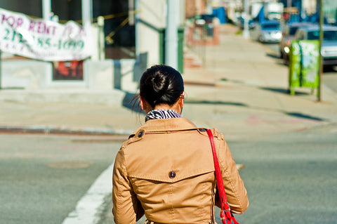back of woman in trench coat