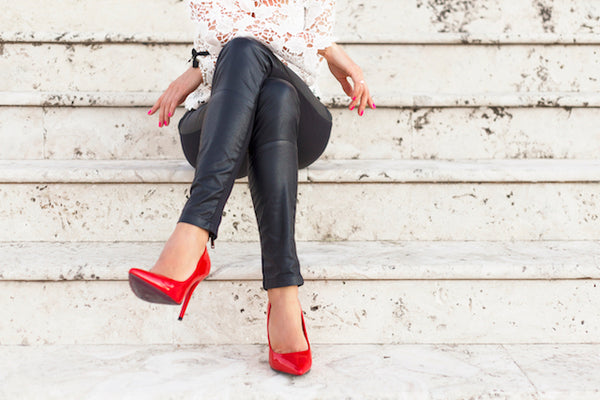 woman in black leather pants and red heels