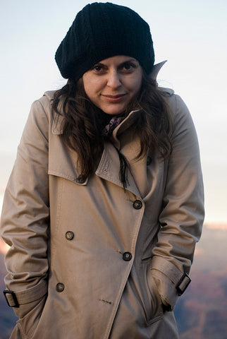 woman in trenchcoat and beanie