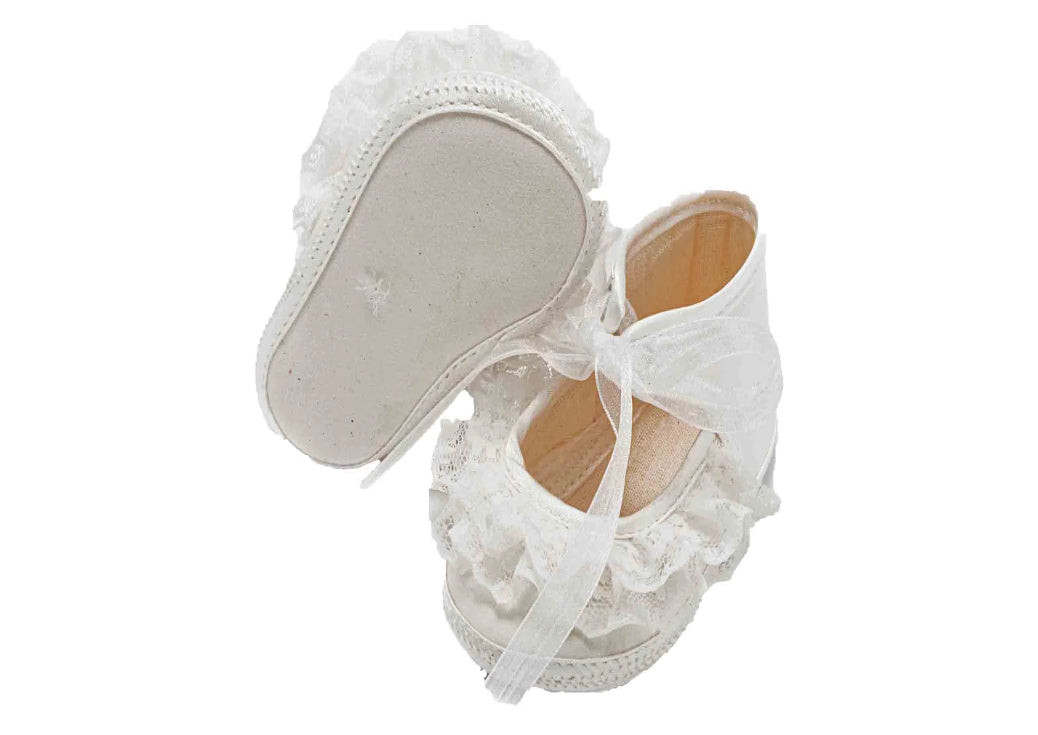 Baby bootee made of satin with lace trim and organza laces