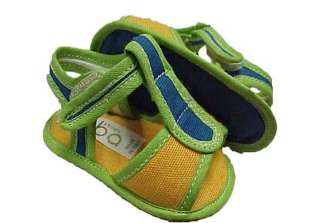 Sandal boldly coloured yellow, green and blue fabric, with velcro strapping