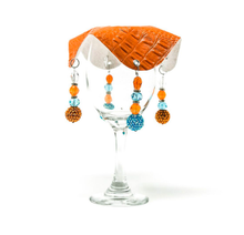 orange drink cover made from vegan leather with beautiful bead work on glass