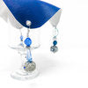 royal blue drink cover with crystals and a straw hole on top