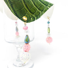 green crocodile skin textured drink cover with clear and pink beads on glass