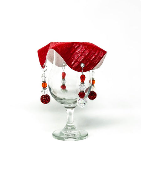 crocodile skin textured drink cover with white and crimson beads on glass,