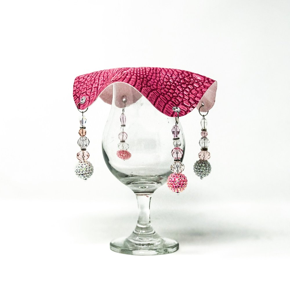 pink crocodile skin textured drink cover with clear and pink beads on glass