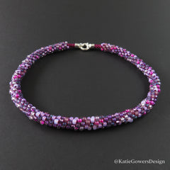 Kumihimo Necklace with beads in magenta and purple from Katie Gowers Design