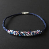 Braided necklace - Pink, white and blue on dark blue