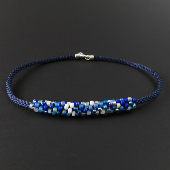 Braided necklace - Blue and white beads on dark blue
