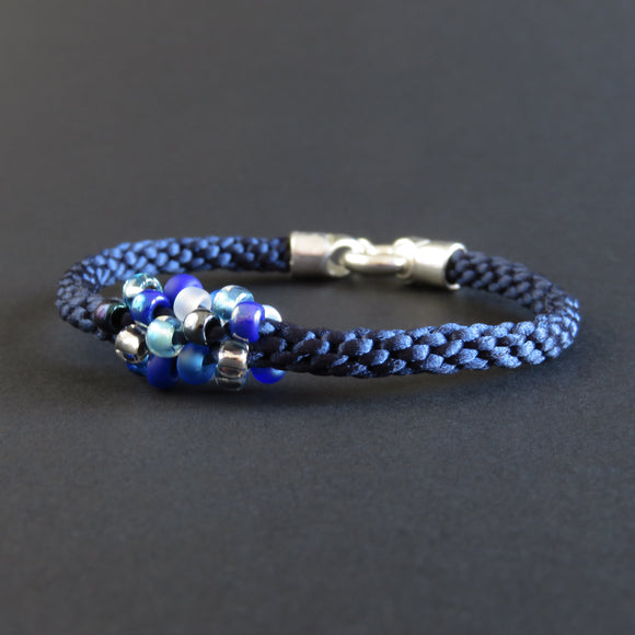 Braided Bracelet With Beads - Blue and White on Dark Blue
