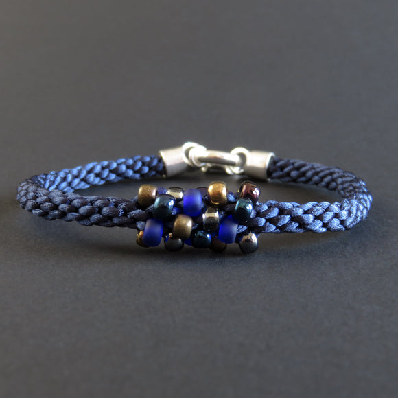 Braided Bracelet With Beads - Blue and Bronze on Dark Blue