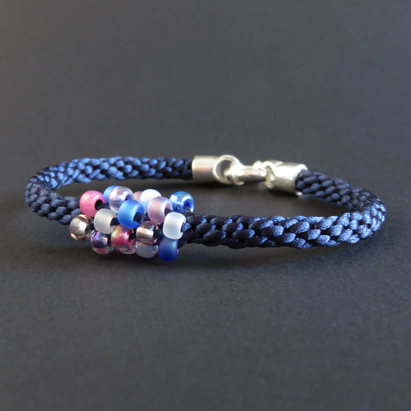 Braided Bracelet With Beads - Pink, White and Blue on Dark Blue